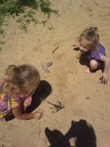 Adriana and Peyton playing in dirt