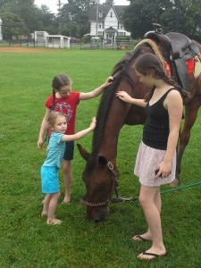 Peyton Avery Morgan petting horse